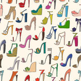 Seamless pattern of various types of female shoes with heels Stock Photos
