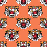 Seamless pattern. Vector illustration of cartoon Tiger head. Seamless pattern. Vector illustration of cartoon Tiger head . Wild animal background Royalty Free Stock Image