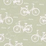 Seamless pattern with vintage bicycles on green background. Vector illustration. Royalty Free Stock Photography