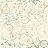 Seamless pattern with vintage bicycles on green background. Vector illustration. Royalty Free Stock Image