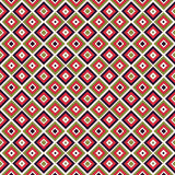 Seamless pattern in vivid colors. Repeated squares and rhombuses bright ornamental abstract background. Royalty Free Stock Photos