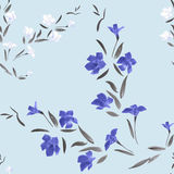 Seamless pattern waite and blue  flowers on a light blue background Stock Photo