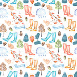 Seamless pattern with watercolor autumn objects warm hat and mittens, rubber boots, rain cloud, dry tree leaves and other Royalty Free Stock Photography