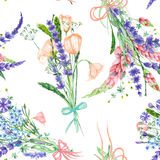 A seamless pattern with the watercolor beautiful bouquets of the tender pink and purple spring wildflowers on a white background Royalty Free Stock Images