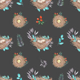 Seamless pattern with watercolor bird nests with eggs, in plants and berries Royalty Free Stock Images