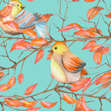 Seamless pattern of the watercolor birds on the branches with red leaves, hand drawn on a blue background Stock Photos