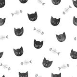 Seamless pattern with watercolor black cats and fishbones. Royalty Free Stock Image