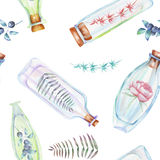 Seamless pattern with watercolor bottles with forest branches with leaves and flowers inside Stock Photography