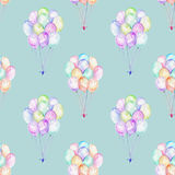 Seamless pattern with watercolor bundle of balloons. Hand drawn isolated on a blue background Royalty Free Stock Photography