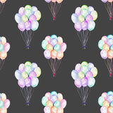 Seamless pattern with watercolor bundle of balloons. Hand drawn isolated on a dark background Stock Image