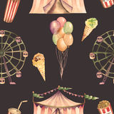 A seamless pattern with the watercolor circus elements: air balloons, pop corn, circus tent (marquee), ice cream and  Ferris wheel. A seamless pattern with the Royalty Free Stock Image