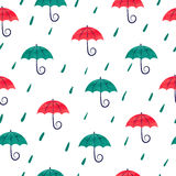 Seamless pattern with watercolor colorful umbrellas. Rain background. Rain drops and umbrellas on white stock illustration