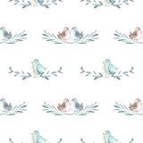 Seamless pattern with watercolor cute birds on the branches Stock Images