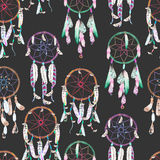 Seamless pattern with watercolor dreamcatchers, hand drawn on a dark background Stock Images