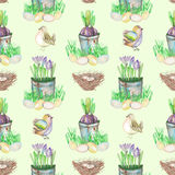 Seamless pattern with watercolor Easter bird eggs, nests, crocus flowers in the pots and cute birds. Hand drawn on a light green background Stock Photos