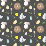 Seamless pattern with watercolor Easter rabbits, bird nests, eggs, birds, yellow and green branches. Hand drawn isolated on a dark background Stock Photography