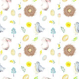 Seamless pattern with watercolor Easter rabbits, bird nests, eggs, birds, yellow and green branches. Hand drawn isolated on a white background Stock Photo