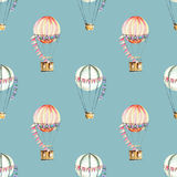 Seamless pattern with watercolor festive air balloons aerostats. Hand drawn isolated on a blue background Royalty Free Stock Photos