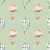 Seamless pattern with watercolor festive air balloons aerostats. Hand drawn isolated on a green  background Royalty Free Stock Photography