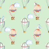 Seamless pattern with watercolor festive air balloons, clouds and cute birds. Hand drawn isolated on a green background Royalty Free Stock Images