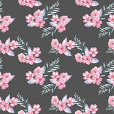 Seamless pattern with watercolor floral bouquets from tender pink flowers and leaves. Hand drawn on a dark background Stock Images