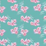 Seamless pattern with watercolor floral bouquets from tender pink flowers and leaves. Hand drawn on a green background Stock Photography