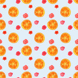 Seamless pattern with watercolor flowers and slices of orange Stock Images
