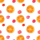 Seamless pattern with watercolor flowers and slices of orange Royalty Free Stock Photo