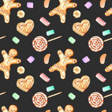 Seamless pattern with watercolor gingerbreads and marshmallow. Hand drawn  on a dark background Stock Photography