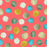 Seamless pattern with the watercolor green, yellow, mint spots (blots) hand drawn on a coral background Royalty Free Stock Photos