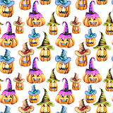 Seamless pattern with watercolor Halloween pumpkins in old hats Stock Photo
