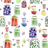 Seamless pattern with watercolor illustration. With different jars with canned fruit jams, vegetables and berries Stock Images