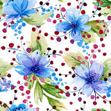 Seamless pattern with watercolor leaves and blue flowers. Stock Photo