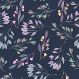 Seamless pattern with watercolor leaves and branches on a dark blue background Royalty Free Stock Images