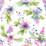 Seamless pattern with watercolor leaves and flowers. Stock Photo