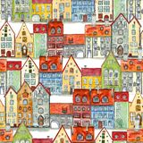 Seamless pattern of watercolor medieval houses. Seamless pattern of watercolor hand drawn old medieval houses, european old town street vew. Design for wallpaper royalty free illustration