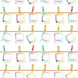 Seamless pattern with watercolor polaroid snapshots attached with clothespins to the ropes Stock Image
