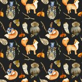 Seamless pattern of watercolor pretty foxes, owls and forest natural elements. Hand drawn on a dark background royalty free stock photos