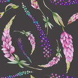 Seamless pattern with the watercolor purple lupine flowers and abstract mimosa flowers Stock Photos