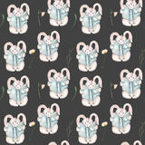 Seamless pattern with watercolor rabbits with books and flowers Royalty Free Stock Images