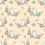 Seamless pattern with watercolor rabbits, green branches and red berries Royalty Free Stock Photo
