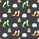 Seamless pattern with watercolor rain elements: rain cloud, autumn trees and rubber boots. Hand drawn isolated on a dark background royalty free illustration