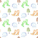 Seamless pattern with watercolor rain elements: rain cloud, autumn trees and rubber boots. Hand drawn on a white background royalty free illustration