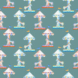 Seamless pattern with watercolor red and blue carousel with horses from the amusement park Royalty Free Stock Photo