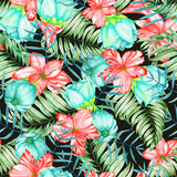 A seamless pattern with the watercolor red and turquoise exotic flowers, hibiscus and the leaves of the palms Stock Images