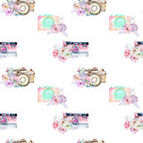 Seamless pattern with watercolor retro cameras in floral decor Stock Photos