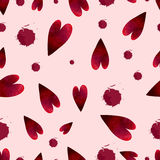 Seamless pattern with watercolor stains and hearts on pink background Stock Photos