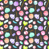 Seamless pattern with watercolor sweets candies, lollipop, marshmallow and paste. Hand drawn isolated on a dark background Royalty Free Stock Image