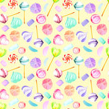 Seamless pattern with watercolor sweets candies, lollipop, marshmallow and paste. Hand drawn isolated on a light yellow background Stock Images