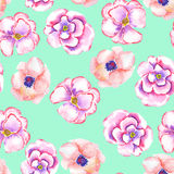 A seamless pattern with the watercolor tender pink spring wildflowers painted on a mint background Royalty Free Stock Image